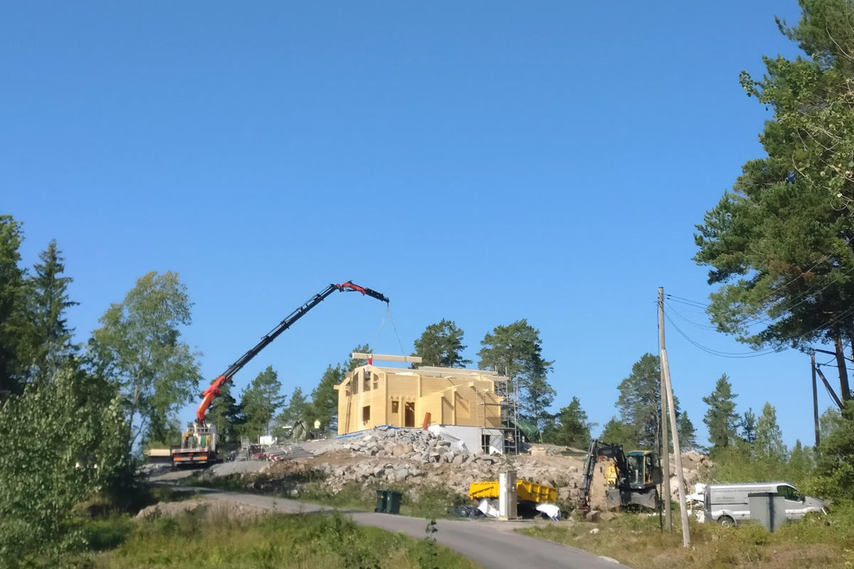 Construction of a modern log house in Stockholm, Sweden
