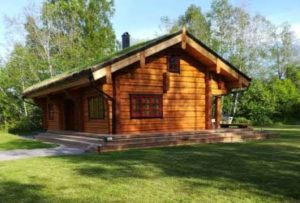 Swedish log cabin with green grass roof